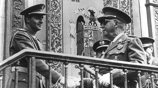 Juan Carlos I y Francisco Franco